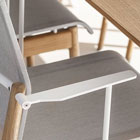 Sway chair with detail of white arm